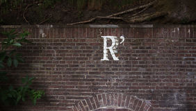Brown Brick Wall With R Paint Royalty Free Stock Photography
