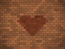 Brown brick wall with red heart. Stock Images