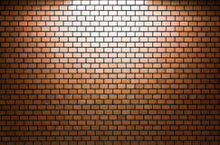 Brown Brick wall with spotlight Stock Image