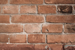 Brown brick wall texture. Old cracked Brown brick wall texture cement Stock Images