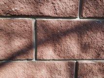 Brown brick wall. Uneven dextura. Brick background stock photo