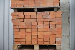 Brown bricks batch on wooden storage tray Stock Image