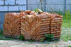 Brown bricks on pallets at the construction site Stock Images