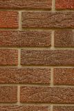 Brown bricks texture of a house wall fragment Stock Image
