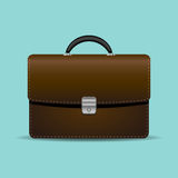 Brown briefcase on turquiose background Stock Photography