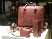 Brown briefcase and wallet, belt Royalty Free Stock Photos