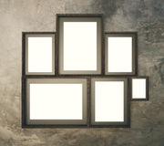 Brown broad pattern wall with multiple blank picture frames, 3D Stock Photography