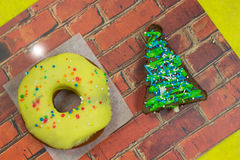 Brown brownie cake in the shape of a triangle. Bagel with yellow icing Stock Images