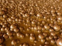 Brown Bubbles. Shiny brown bubbles float in a chocolate type liquid Royalty Free Stock Image
