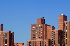 Brown buildings against blue sky. Group of brown high-rise buildings in new york city Stock Photography