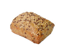 Brown bun with sesame and sunflower seeds. On white background royalty free stock photo