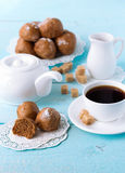 Brown buns on blue wooden table with coffee cup. Sugar, coffee pot and milk jug Stock Photography