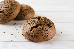 Brown buns sprinkled with caraway seeds Stock Image