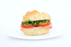 Brown burger bun salad sandwich. Isolated on white with copy space Royalty Free Stock Image
