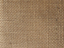 Brown burlap hessian fabric background. Brown burlap hessian texture useful as a background royalty free stock photography