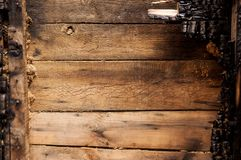 Brown burnt wall of house of wooden planks with embossed texture. background for copy space. concept of loss of real estate or stock photo