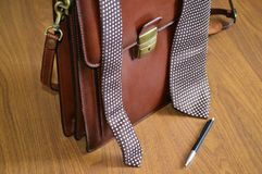 Brown business briefcase,with tie and pen. stock photography