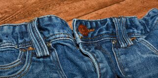 Brown Button on Blue Denim Bottom Royalty Free Stock Image