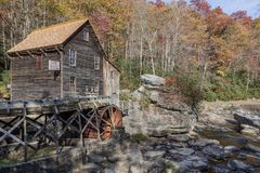Brown Cabin Under Water Wheel Stock Photography