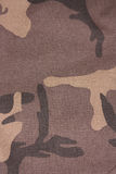 Brown camouflage seamless fabric background Stock Image