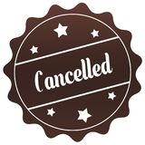 Brown CANCELLED stamp on white background. Stock Photos