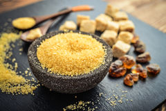 Brown cane sugar in bowl Stock Photography