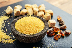 Brown cane sugar in bowl Stock Photo