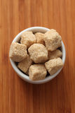 Brown cane sugar in a bowl Royalty Free Stock Photos