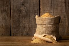 Brown cane sugar in burlap bag royalty free stock photos