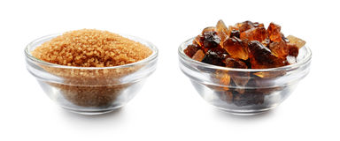 Brown cane sugar and caramelized sugar in glass bowls Stock Image