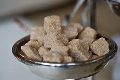 Brown cane sugar crystalline lump sweet sugar closeup Stock Image