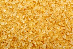 Brown cane sugar crystals Royalty Free Stock Images