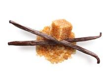 Brown cane sugar cube and vanilla pods Royalty Free Stock Image