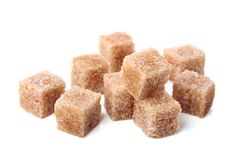 Brown cane sugar cubes. Isolated on a white background Stock Photography