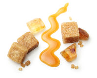 Brown cane sugar cubes and caramel Royalty Free Stock Image