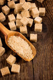 Brown cane sugar cubes and granules Royalty Free Stock Image