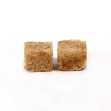 Brown cane sugar cubes Stock Images