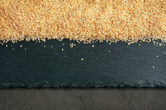 Brown cane sugar Stock Images