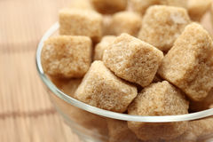 Brown cane sugar in a glass bowl Royalty Free Stock Photography