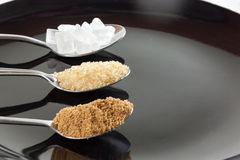 Brown cane sugar and granulated sugar and rock sugar Stock Photo