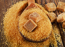 Brown cane sugar on  a old wooden board Stock Image