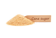 Brown cane sugar at plate Royalty Free Stock Image