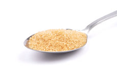 Brown cane sugar on spoon Royalty Free Stock Images