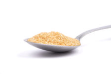 Brown cane sugar on spoon Royalty Free Stock Photo