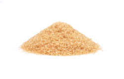 Brown cane sugar on white Royalty Free Stock Photography