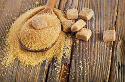 Brown Cane Sugar in  wooden spoon. Stock Photo