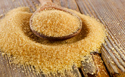 Brown cane sugar  in   wooden spoon Royalty Free Stock Photos