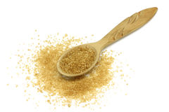 Brown cane sugar in a wooden spoon Stock Images