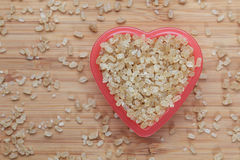 Brown cane sugars in a heart bowl Stock Photos