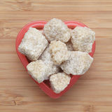 Brown cane sugars in a heart bowl Royalty Free Stock Image